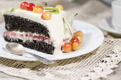 Slice of bird-cherry flour cake with cherries, strawberries and kiwi. Bird-cherry flour cake with cherries, strawberries and kiwi. Homemade cake. From series stock image