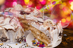 Slice of birthday cake with different chocolate ornaments stuffe Stock Image