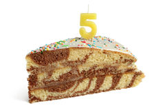 Slice of birthday cake with number five candle Royalty Free Stock Image