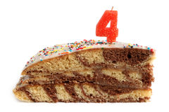 Slice of birthday cake with number four candle Stock Photo