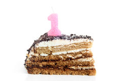 Slice of birthday cake with number one candle Royalty Free Stock Photo