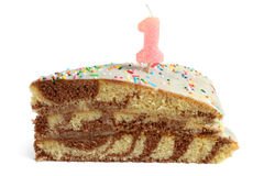 Slice of birthday cake with number one candle Stock Photos