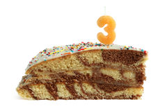 Slice of birthday cake with number three candle Royalty Free Stock Photography
