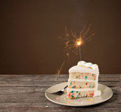 Slice of Birthday Cake with Sparkler Royalty Free Stock Images