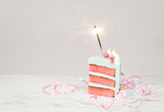Slice of Birthday Cake with sparkler Royalty Free Stock Photos