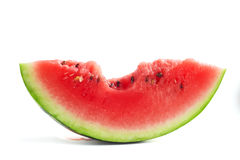 Slice of bitten watermelon. Isolated on white background stock photos