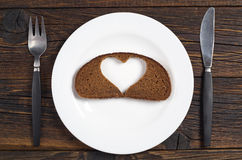 Slice of black bread and cutlery Royalty Free Stock Photos