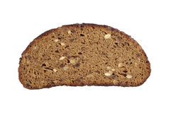Slice of black bread with sunflower seeds, nuts, raisins and dri Royalty Free Stock Photography