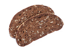 Slice of black rye bread isolated. Closeup view Stock Photos