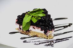 Slice of blackberry cheesecake Royalty Free Stock Photos