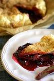 Slice of blackberry pie Stock Photos
