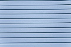 Slice the blue siding. Wooden wall. Slice the blue siding royalty free stock images