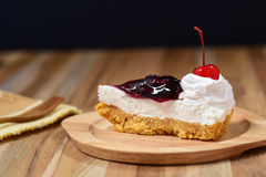 Slice of blueberry cheese cake on wooden plate Royalty Free Stock Image
