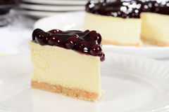 Slice of blueberry cheesecake Stock Images
