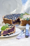 Slice of blueberry pie with mint served with knife and spoon Royalty Free Stock Photos