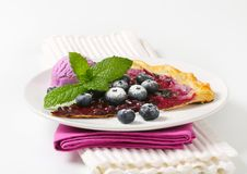 Slice of blueberry tart with ice cream Royalty Free Stock Photography