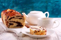 Slice of braided loaf. With filling and cup of tea royalty free stock photography