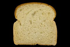 Slice of bread. Isolated on black background with clipping path Stock Images