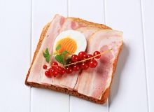 Slice of bread with bacon Royalty Free Stock Image