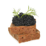 Slice of bread with caviar Stock Images