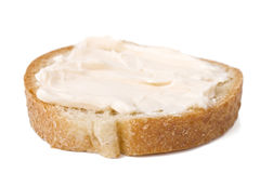 Slice of bread with cheese cream Royalty Free Stock Photos