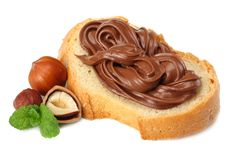 Slice of bread with chocolate cream with hazelnut isolated on white background Stock Photography