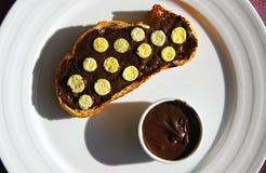 Slice of bread with chocolate cream Stock Photos
