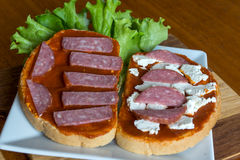 Slice of bread with chutney and feta cheese and salami Royalty Free Stock Photo