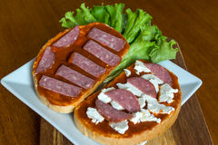 Slice of bread with chutney and feta cheese and salami Royalty Free Stock Photos