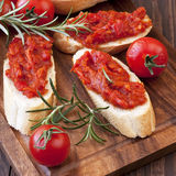 Slice of bread with chutney on wooden board. Stock Image