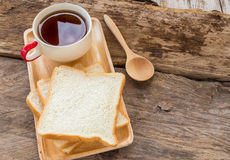 Slice of bread and coffee in wooden plate Royalty Free Stock Photos
