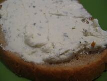 slice-of-bread-with-cream-cheese-and-herbs Stock Image