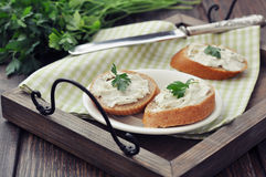 Slice of bread with cream cheese Stock Photography