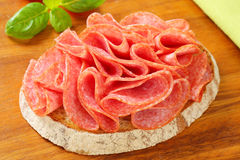 Bread with dry salami Royalty Free Stock Images