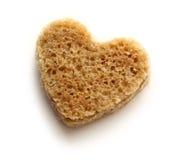 Slice of bread in heart Stock Image