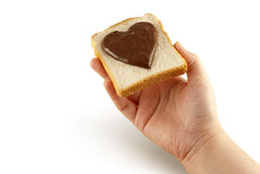 Slice of bread with heart shaped chocolate Royalty Free Stock Image