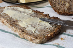 Slice of bread. Homemade slice of bread with butter Royalty Free Stock Image