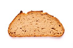 Slice of bread isolated on white background. One single slice of bread isolated on white background, top view directly from above stock images