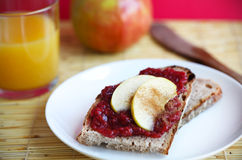 Slice of bread  with jam and apples and cinnamon Stock Photography