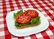 Slice of bread, lettuce and tomato Stock Images