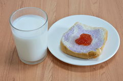 Slice bread mixed with taro topping jam and milk Royalty Free Stock Images