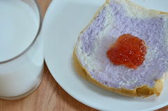 Slice bread mixed with taro topping jam and milk Royalty Free Stock Photo