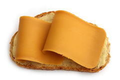 Slice of bread with norwegian brown cheese stock photos