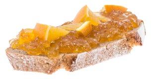 Slice of bread with Orange Jam Stock Photography
