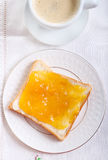Slice of bread with orange marmalade Royalty Free Stock Images