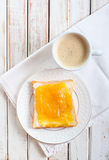 Slice of bread with orange marmalade Stock Images