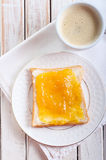 Slice of bread with orange marmalade Royalty Free Stock Photos