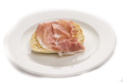 Slice bread with parma ham on white plate. Delicious Stock Photography