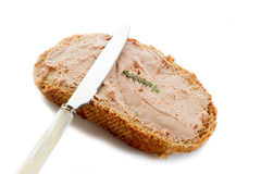 Slice bread with paté. Slice bread with paté and knife Royalty Free Stock Photo