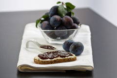 Slice of bread with plum butter Stock Images